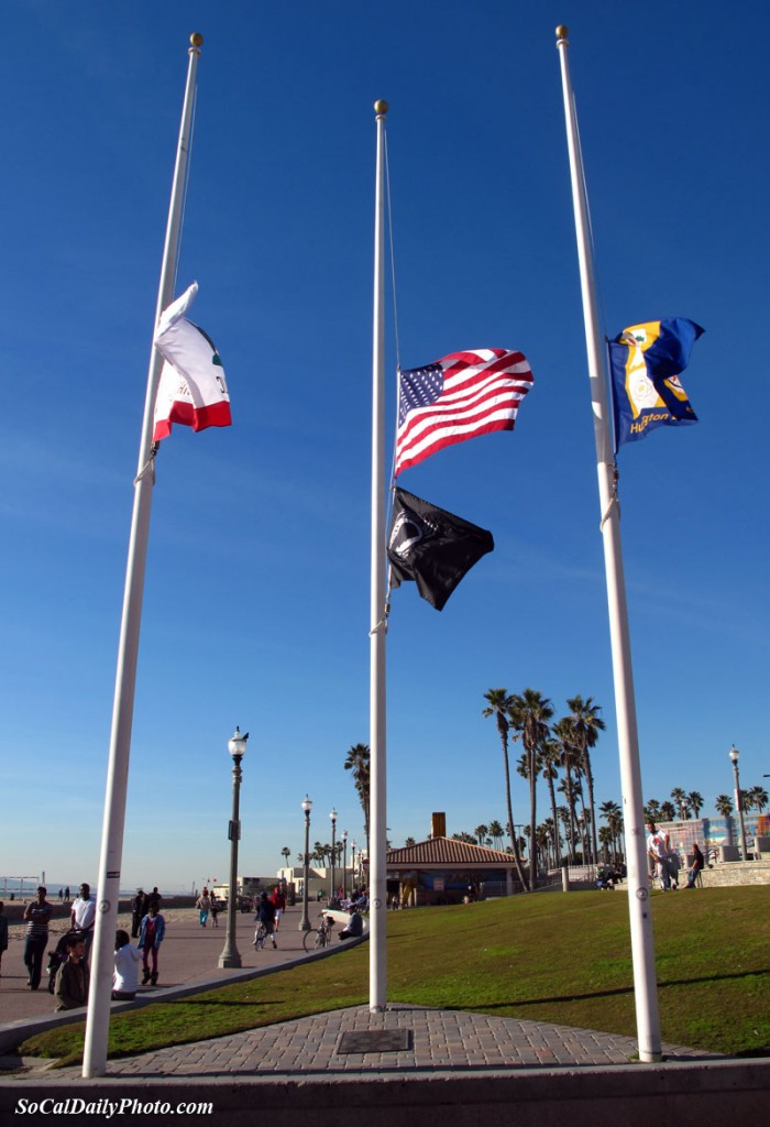Huntington Beach Pier flags at half staff in Honor of Tucson Arizona Victims